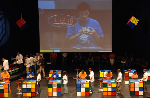 Players compete in solving the Rubik's cubes during the final of the 2007 Rubik's Cube World Championships in Budapest, Hungary, Sunday, Oct. 7, 2007. (AP Photo/Bela Szandelszky)