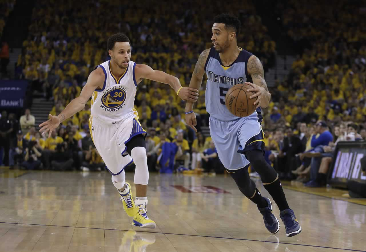 <div class='meta'><div class='origin-logo' data-origin='none'></div><span class='caption-text' data-credit='AP Photo/Ben Margot'>Grizzlies guard Courtney Lee (5) dribbles against Golden State Warriors guard Stephen Curry (30) during the first half of Game 5 in Oakland, Calif., Wednesday, May 13, 2015.</span></div>