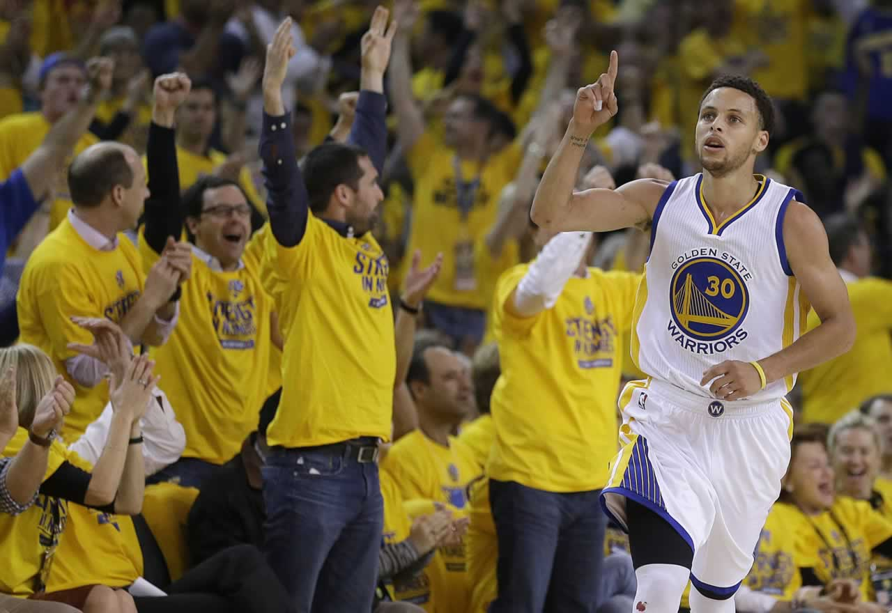 <div class='meta'><div class='origin-logo' data-origin='none'></div><span class='caption-text' data-credit='AP Photo/Ben Margot'>Fans cheer as Warriors guard Stephen Curry scores in front of Grizzlies guard Vince Carter in Game 5 of the Western Conference Semifinals in Oakland, Calif. on Wed., May 13, 2015.</span></div>