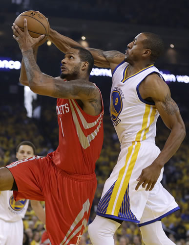 <div class='meta'><div class='origin-logo' data-origin='none'></div><span class='caption-text' data-credit='AP Photo/Tony Avelar'>Houston Rockets forward Trevor Ariza, left, shoots against Golden State Warriors forward Andre Iguodala during the first half of Game 1 of the Western Conference finals.</span></div>
