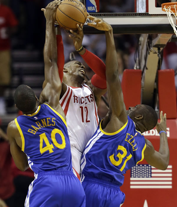 <div class='meta'><div class='origin-logo' data-origin='none'></div><span class='caption-text' data-credit=''>Rockets' Dwight Howard  is defended by Warriors' Harrison Barnes and Festus Ezeli during the first half in Game 3 of the NBA basketball Western Conference finals on May 23, 2015, i</span></div>