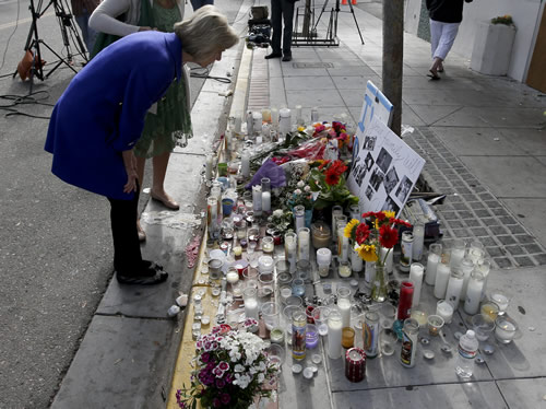 Rep. Lois Capps, D-Santa Barbara, pays her respects at a memorial in front of the IV Deli Mart, where part of a mass shooting took place in Isla Vista, Calif. (AP Photo/Chris Carls