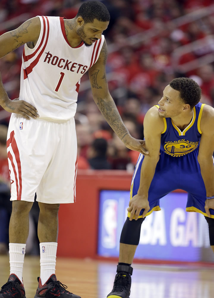 <div class='meta'><div class='origin-logo' data-origin='AP'></div><span class='caption-text' data-credit=''>Houston Rockets' Trevor Ariza talks with Warriors guard Stephen Curry between plays during the second half in Game 4 on Monday, May 25, 2015, in Houston. (AP/David J. Phillip)</span></div>