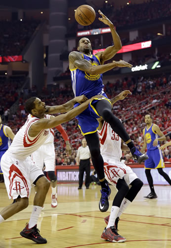 <div class='meta'><div class='origin-logo' data-origin='none'></div><span class='caption-text' data-credit='AP Photo/David J. Phillip'>Golden State Warriors guard Andre Iguodala (9) is fouled by Houston Rockets forward Trevor Ariza (1) during the first half in Game 4 of the Western Conference finals in Houston.</span></div>