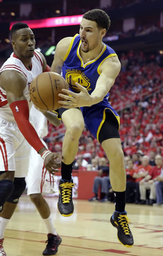 <div class='meta'><div class='origin-logo' data-origin='none'></div><span class='caption-text' data-credit='AP Photo/David J. Phillip'>Golden State Warriors guard Klay Thompson (11) passes around Houston Rockets center Dwight Howard during the second half in Game 4 of the Western Conference finals.</span></div>