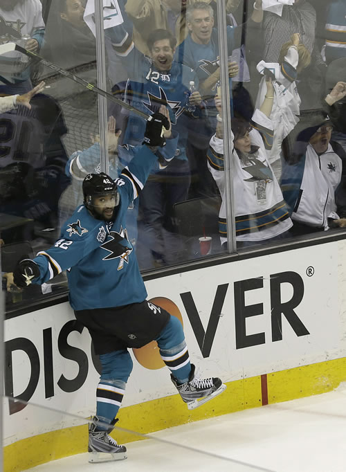 <div class='meta'><div class='origin-logo' data-origin='none'></div><span class='caption-text' data-credit='AP Photo/Jeff Chiu'>San Jose Sharks right wing Joel Ward (42) celebrates after scoring against the St. Louis Blues in Game 6 of the NHL hockey Stanley Cup Western Conference finals in San Jose, Calif.</span></div>