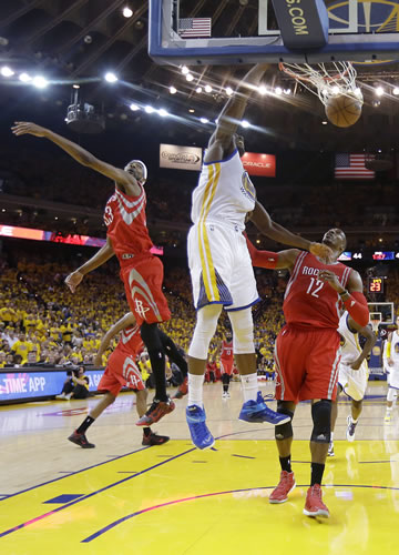<div class='meta'><div class='origin-logo' data-origin='AP'></div><span class='caption-text' data-credit='AP Photo/Tony Avelar'>Golden State Warriors center Festus Ezeli, center, dunks against Houston Rockets guard Jason Terry, left, and center Dwight Howard (12) during the first half of Game 5 in Oakland.</span></div>