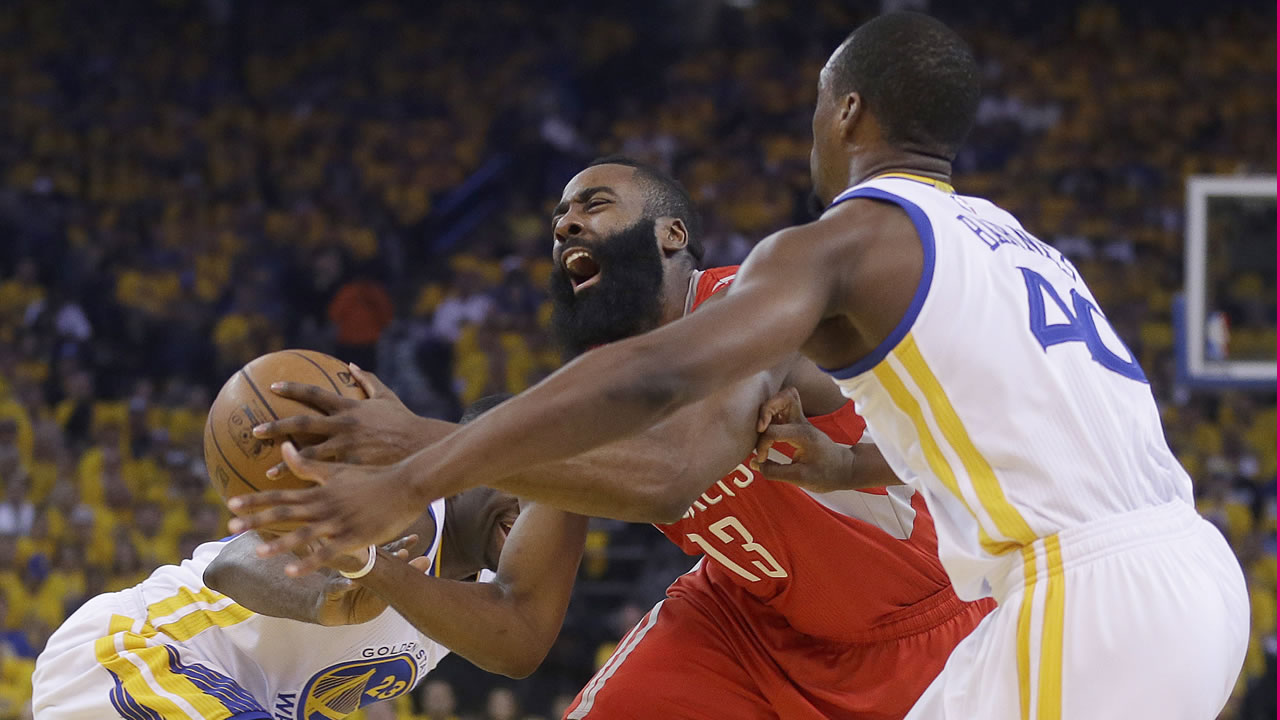 <div class='meta'><div class='origin-logo' data-origin='AP'></div><span class='caption-text' data-credit='AP Photo/Ben Margot'>Houston Rockets guard James Harden (13) drives between Golden State Warriors forward Draymond Green, left, and forward Harrison Barnes during the first half of Game 5 in Oakland.</span></div>