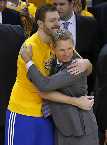 <div class='meta'><div class='origin-logo' data-origin='AP'></div><span class='caption-text' data-credit='AP Photo/Tony Avelar'>Golden State Warriors forward David Lee, left, hugs coach Steve Kerr during the second half of Game 5 of the NBA basketball Western Conference finals against the Houston Rockets.</span></div>
