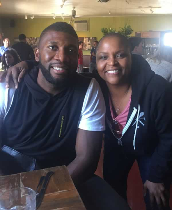 """<div class=""""meta image-caption""""><div class=""""origin-logo origin-image none""""><span>none</span></div><span class=""""caption-text"""">In this undated photo, Warriors player Festus Ezeli posts with restaurant owner Tanya Holland at Brown Sugar Kitchen in Oakland, Calif. (KGO-TV)</span></div>"""