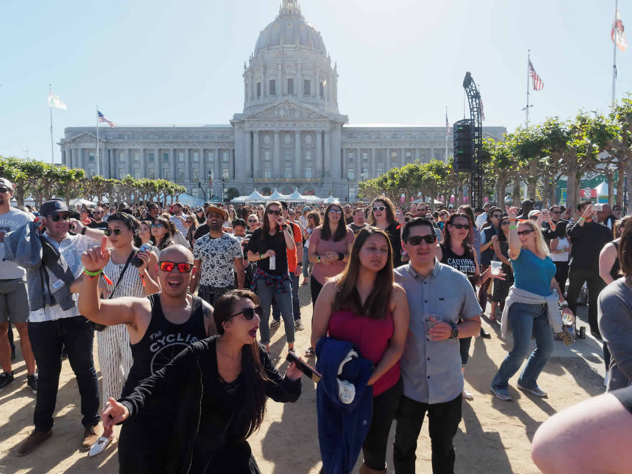 <div class='meta'><div class='origin-logo' data-origin='none'></div><span class='caption-text' data-credit='KGO-TV'>A crowd of people smile as they watch music performances at Clusterfest in San Francisco, Calif. on June 2, 2018.</span></div>