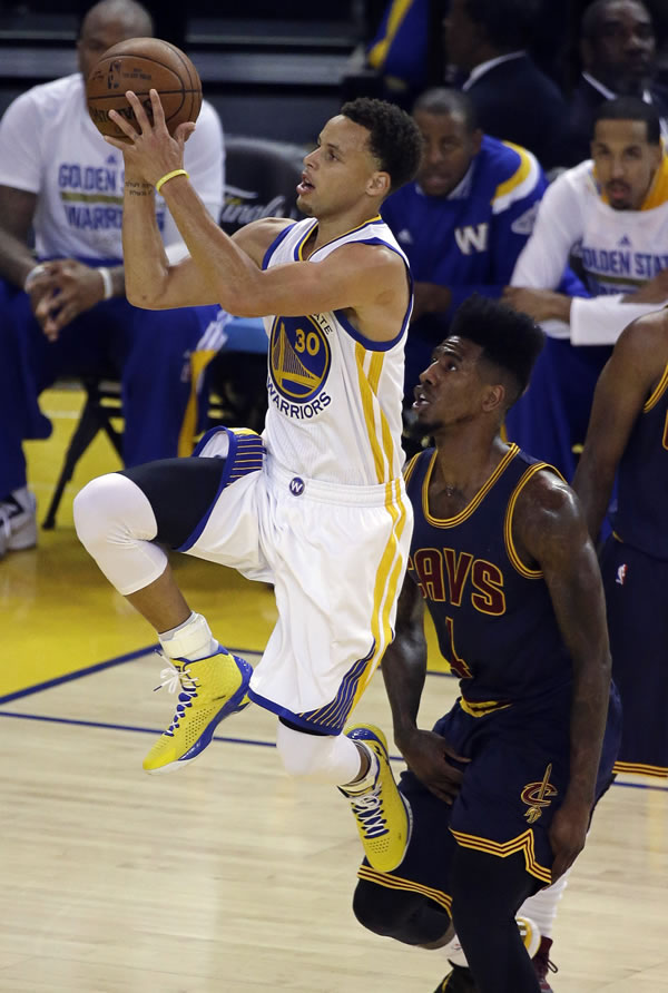 <div class='meta'><div class='origin-logo' data-origin='none'></div><span class='caption-text' data-credit='AP Photo/Eric Risberg'>Warriors guard Stephen Curry shoots against Cavaliers guard Iman Shumpert during the first half of Game 1 of basketball's NBA Finals in Oakland, Calif., Thursday, June 4, 2015.</span></div>
