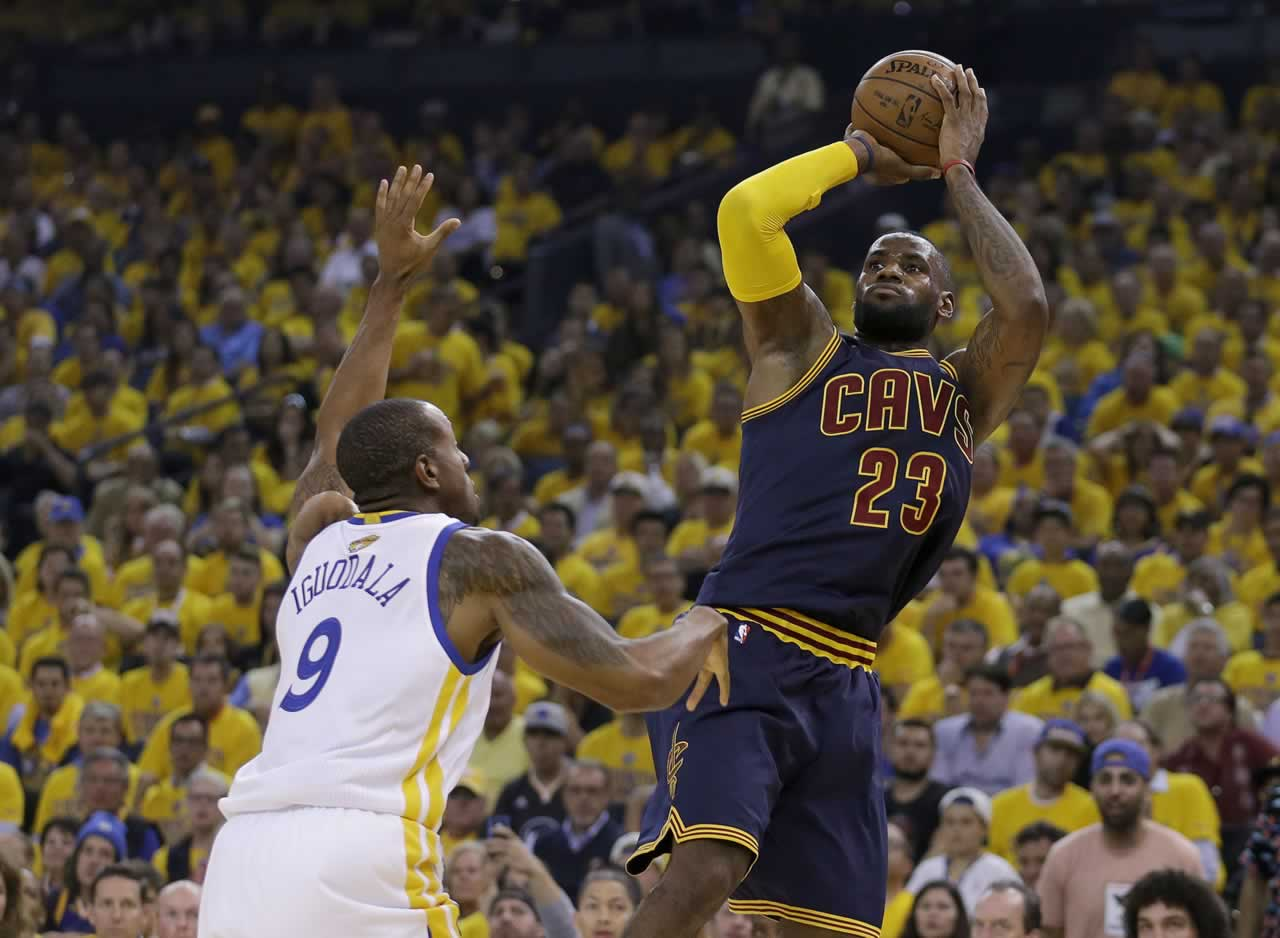 <div class='meta'><div class='origin-logo' data-origin='none'></div><span class='caption-text' data-credit='AP Photo/Ben Margot'>Cavaliers forward LeBron James shoots against Warriors forward Andre Iguodala during the first half of Game 1 of basketball's NBA Finals in Oakland, Calif., Thursday, June 4, 2015.</span></div>