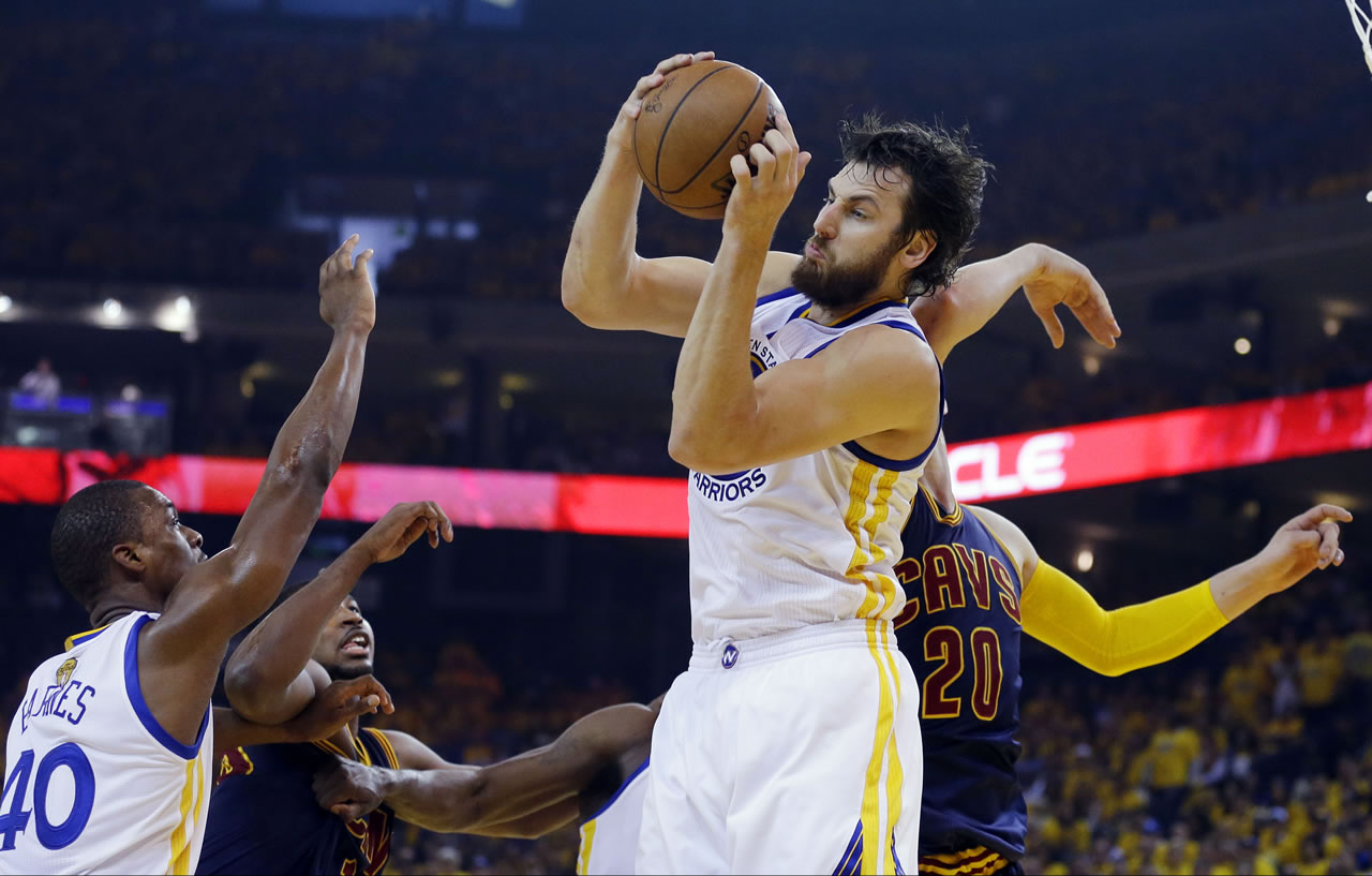 <div class='meta'><div class='origin-logo' data-origin='none'></div><span class='caption-text' data-credit='AP Photo/Ben Margot'>Warriors center Andrew Bogut grabs a rebound in front of Cavaliers center Timofey Mozgov during the first half of Game 1 of basketball's NBA Finals in Oakland, Calif., June 4, 2015</span></div>