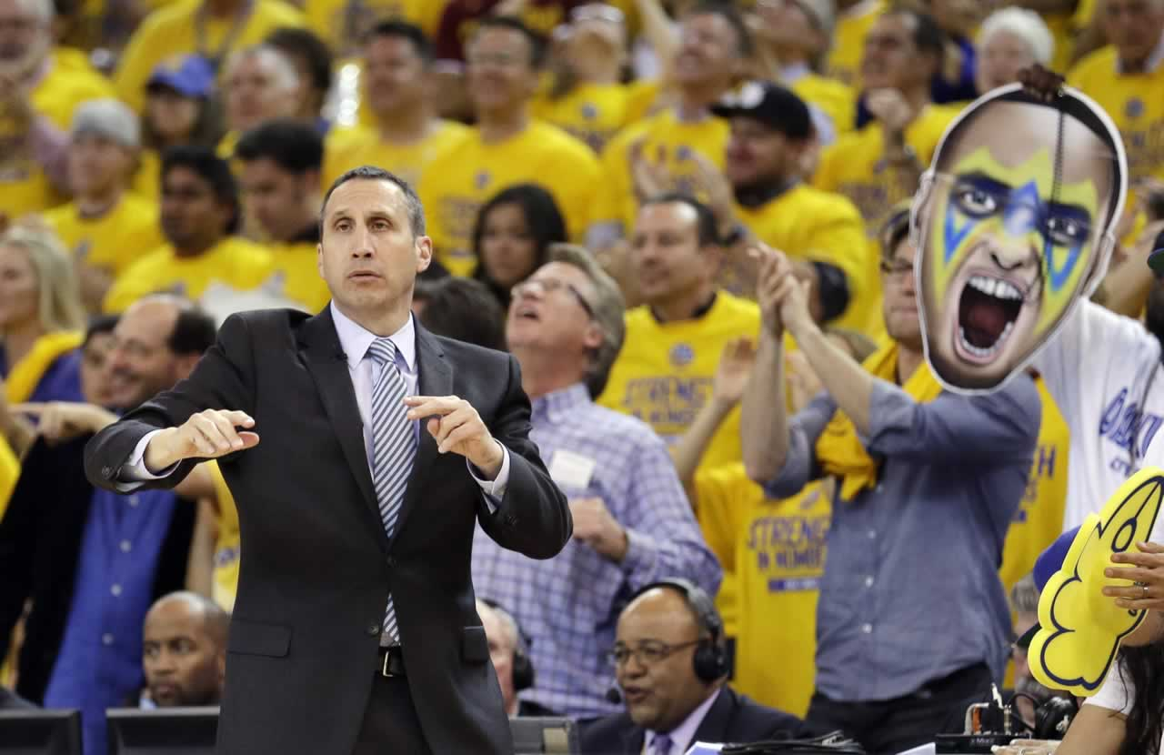 <div class='meta'><div class='origin-logo' data-origin='none'></div><span class='caption-text' data-credit='AP Photo/Ben Margot'>Cavaliers head coach David Blatt gestures as a fan holds up a large photo of Warriors guard Stephen Curry in Game 1 of basketball's NBA Finals in Oakland, Calif., Thursday, June 4,</span></div>