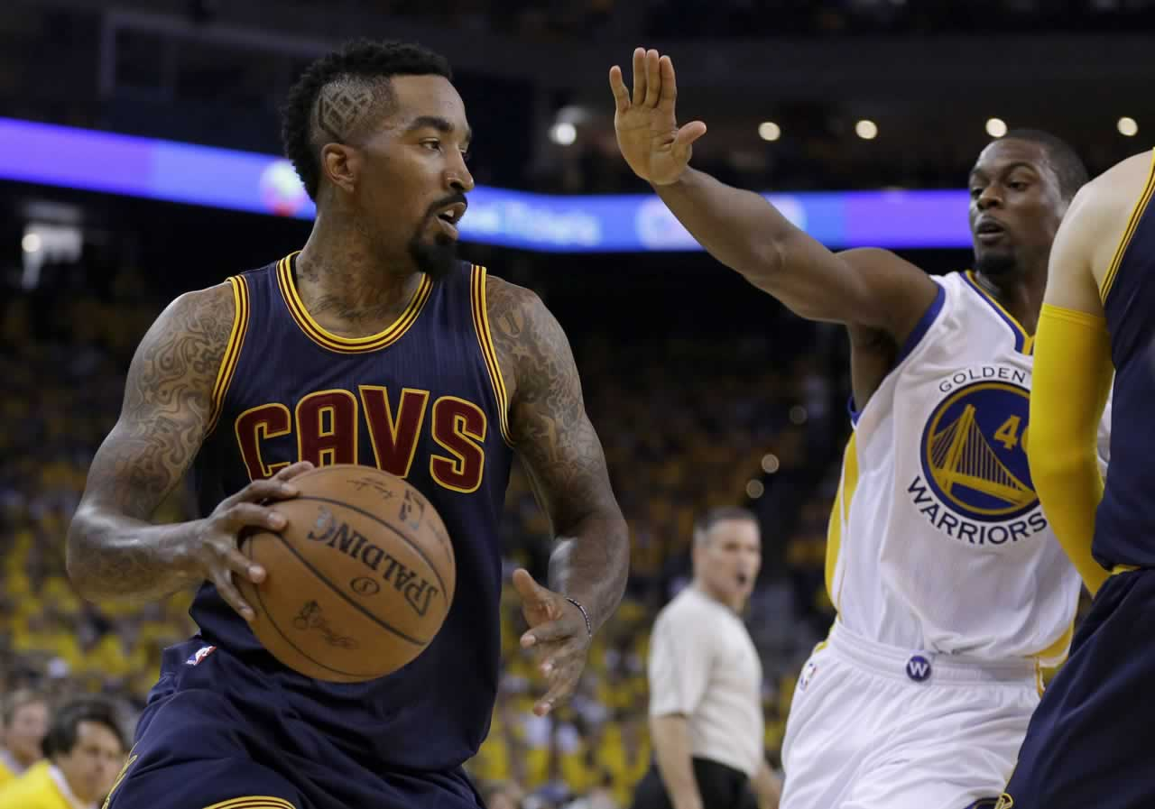 <div class='meta'><div class='origin-logo' data-origin='none'></div><span class='caption-text' data-credit='AP Photo/Ben Margot'>Cavaliers guard J.R. Smith dribbles against Warriors forward Harrison Barnes during Game 1 of basketball's NBA Finals in Oakland, Calif., Thursday, June 4, 2015.</span></div>