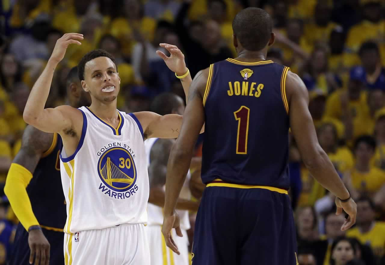 <div class='meta'><div class='origin-logo' data-origin='none'></div><span class='caption-text' data-credit='AP Photo/Ben Margot'>Warriors guard Stephen Curry reacts next to Cavaliers forward James Jones during Game 1 of basketball's NBA Finals in Oakland, Calif., Thursday, June 4, 2015.</span></div>