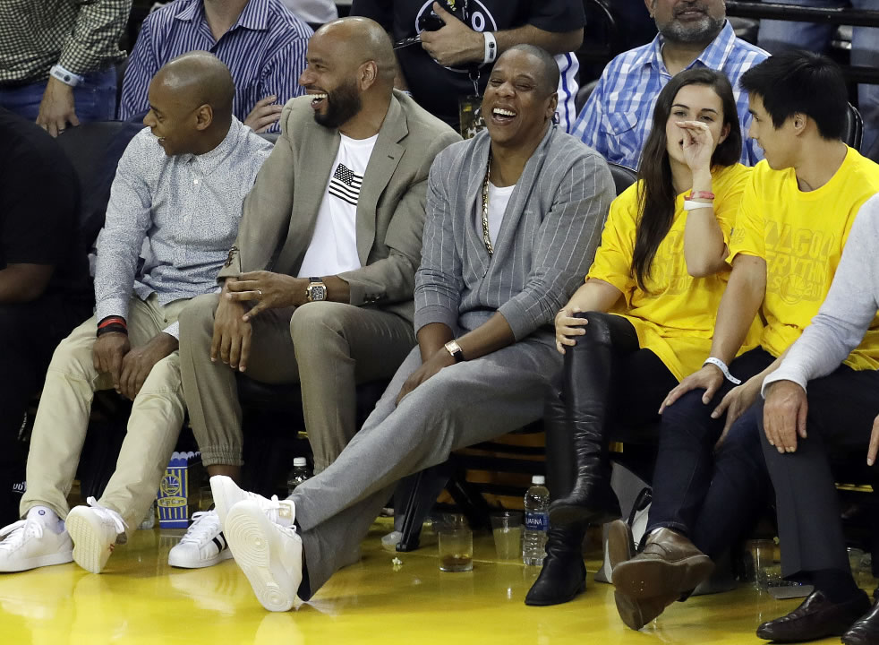 "<div class=""meta image-caption""><div class=""origin-logo origin-image none""><span>none</span></div><span class=""caption-text"">Rapper Jay-Z, center, watches Game 1 of basketball's NBA Finals between the Golden State Warriors and the Cleveland Cavaliers Thursday, June 1, 2017, in Oakland, Calif.  (AP Photo/Marcio Jose Sanchez)</span></div>"