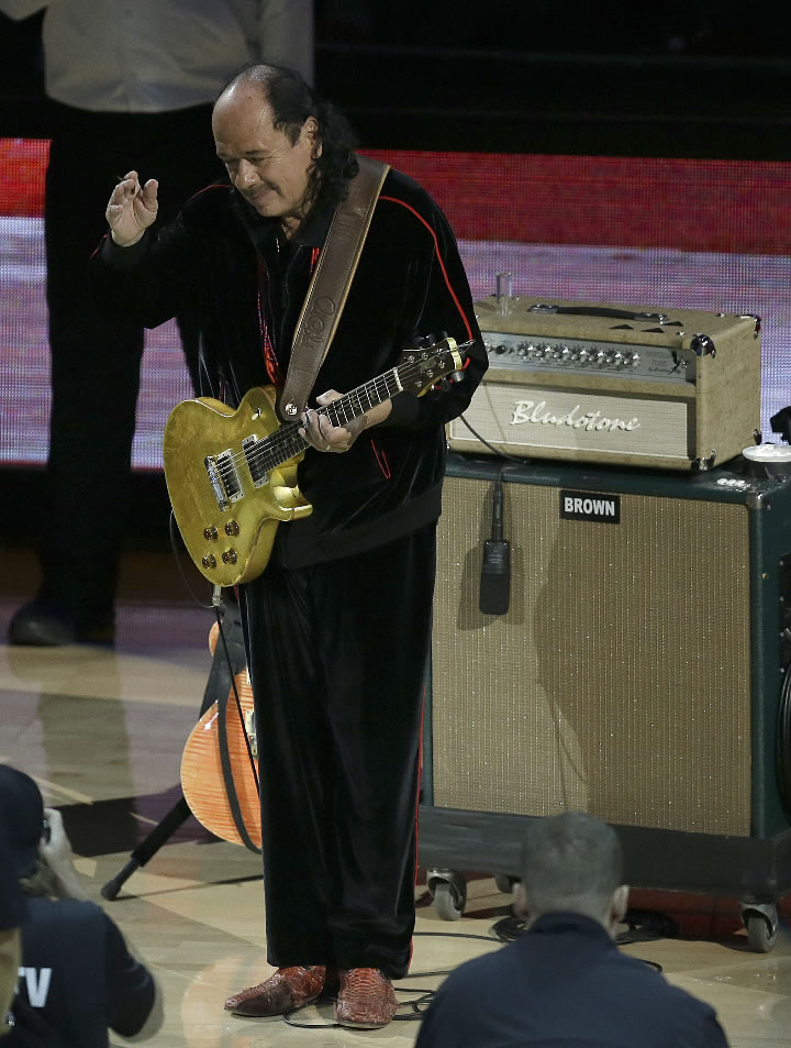 "<div class=""meta image-caption""><div class=""origin-logo origin-image none""><span>none</span></div><span class=""caption-text"">Carlos Santana performs the national anthem before Game 2 of the NBA Finals between the Golden State Warriors and the Cleveland Cavaliers in Oakland, Calif., on June 4, 2017. (AP Photo/Ben Margot)</span></div>"
