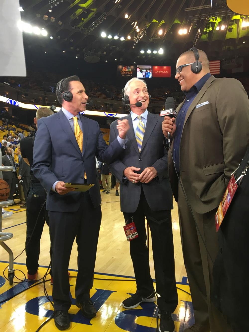 "<div class=""meta image-caption""><div class=""origin-logo origin-image none""><span>none</span></div><span class=""caption-text"">Larry Beil, Mike Shumann and ESPN's Marc Spears talk basketball before game 2 of the NBA Finals in Oakland, Calif. on Sunday, June 4, 2017. (KGO-TV)</span></div>"