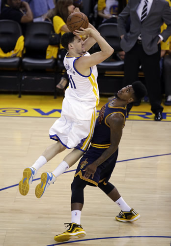<div class='meta'><div class='origin-logo' data-origin='none'></div><span class='caption-text' data-credit='AP Photo/Ben Margot'>Golden State Warriors guard Klay Thompson (11) loses the ball next to Cleveland Cavaliers guard Iman Shumpert (4) during the second half of Game 2 of basketball's NBA Finals.</span></div>