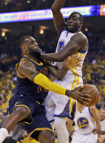 <div class='meta'><div class='origin-logo' data-origin='none'></div><span class='caption-text' data-credit='AP Photo/Ben Margot'>leveland Cavaliers forward LeBron James, left, passes the ball as Golden State Warriors forward Draymond Green defends during the first half of Game 2 of basketball's NBA Finals.</span></div>