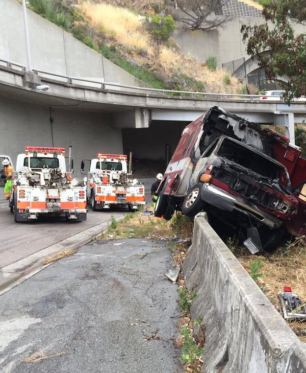 "<div class=""meta image-caption""><div class=""origin-logo origin-image none""><span>none</span></div><span class=""caption-text"">An ambulance caught fire after police say they pursued it to the eastbound Treasure Island off ramp from the Bay Bridge, Tuesday, June 7, 2016. (CHP San Francisco/Twitter)</span></div>"