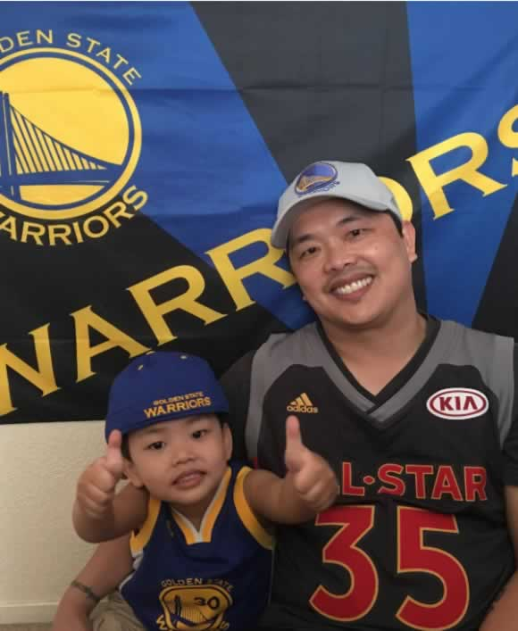 <div class='meta'><div class='origin-logo' data-origin='none'></div><span class='caption-text' data-credit='Photo by Ferdinand Garcia/Facebook'>A young Warriors fan gives a thumbs up with his dad in this photo shared on Thursday, June 8, 2017.</span></div>