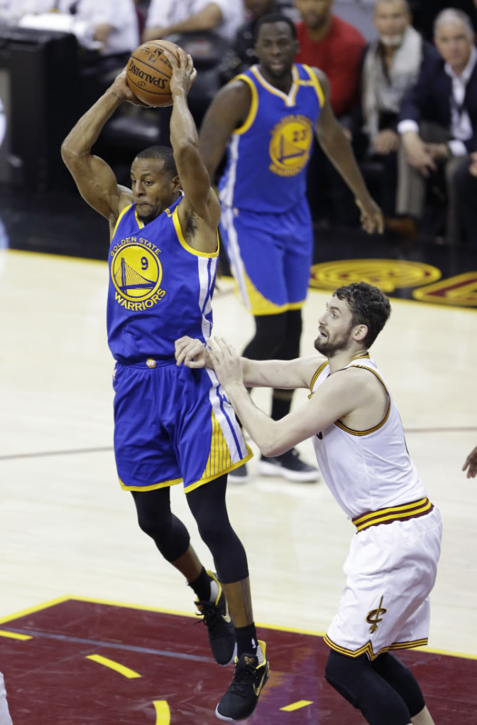 """<div class=""""meta image-caption""""><div class=""""origin-logo origin-image none""""><span>none</span></div><span class=""""caption-text"""">Warriors forward Andre Iguodala (9) passes as Cavaliers forward Kevin Love (0) defends during the first half of Game 4 of basketball's NBA Finals in Cleveland on June 9, 2017. (AP Photo/Tony Dejak)</span></div>"""