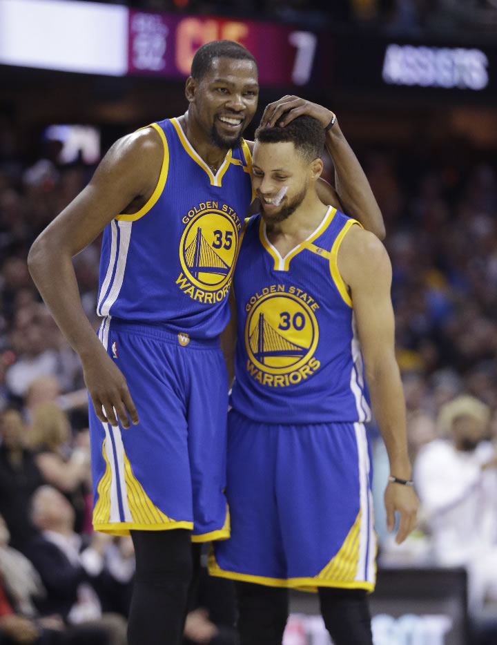 """<div class=""""meta image-caption""""><div class=""""origin-logo origin-image none""""><span>none</span></div><span class=""""caption-text"""">Warriors' Kevin Durant (35) hugs Stephen Curry (30) during the first half against the Cavaliers in Game 4 of basketball's NBA Finals in Cleveland, Friday, June 9, 2017. (AP Photo/Tony Dejak)</span></div>"""