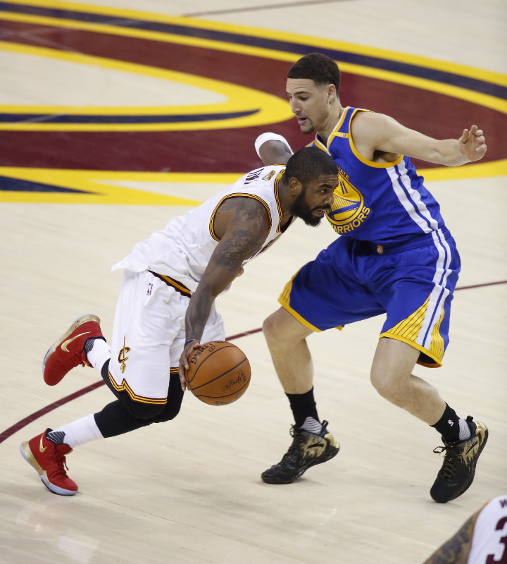 """<div class=""""meta image-caption""""><div class=""""origin-logo origin-image none""""><span>none</span></div><span class=""""caption-text"""">Cavaliers guard Kyrie Irving (2) drives on Golden State Warriors guard Klay Thompson (1om1) during the first half of Game 4 of basketball's NBA Finals in Cleveland on June 9, 2017. (AP Photo/Ron Schwane)</span></div>"""