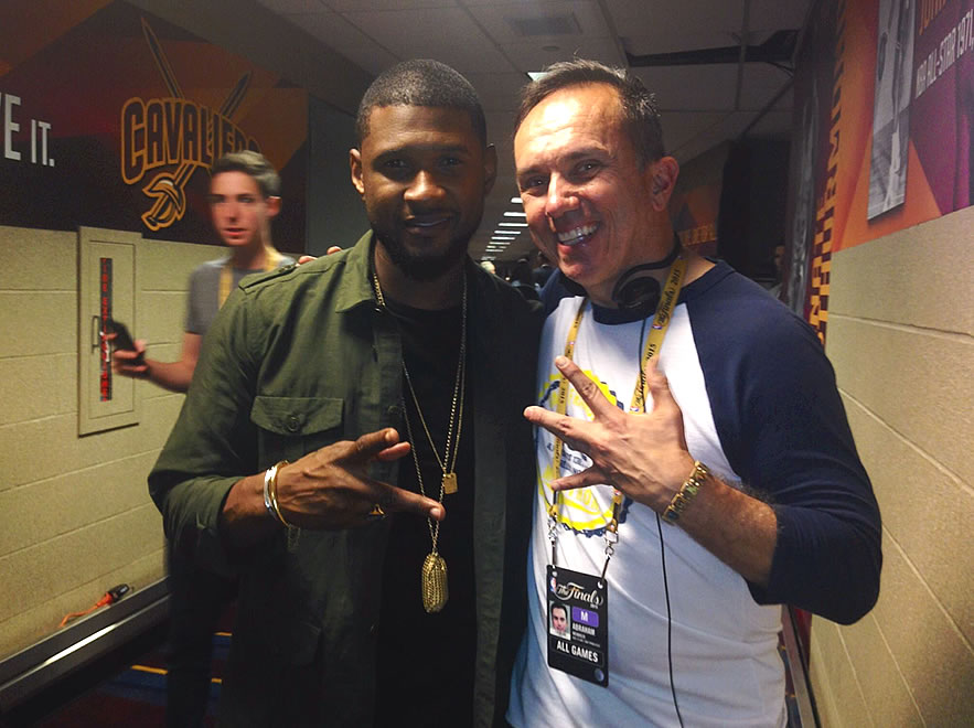 <div class='meta'><div class='origin-logo' data-origin='none'></div><span class='caption-text' data-credit=''>Here is ABC7 Sports photographer Abe Mendoza (right) who ran into Usher after he sang the &#34;Star-Spangled Banner&#34; at NBA Finals Game 3 in Cleveland, Ohio on June 11, 2015.  (KGO-TV)</span></div>