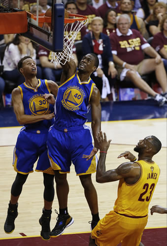 <div class='meta'><div class='origin-logo' data-origin='none'></div><span class='caption-text' data-credit='AP Photo/Paul Sancya'>Golden State Warriors forward Harrison Barnes (40) gets a slam dunker in front of teammate Stephen Curry and Cleveland Cavaliers forward LeBron James (23).</span></div>