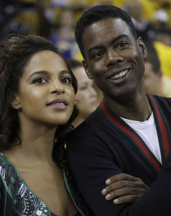 <div class='meta'><div class='origin-logo' data-origin='none'></div><span class='caption-text' data-credit='AP Photo/Marcio Jose Sanchez'>Comedian Chris Rock, right, smiles next to Megalyn Echikunwoke before Game 5 of the  NBA Finals in Oakland, Calif., Monday, June 12, 2017.</span></div>