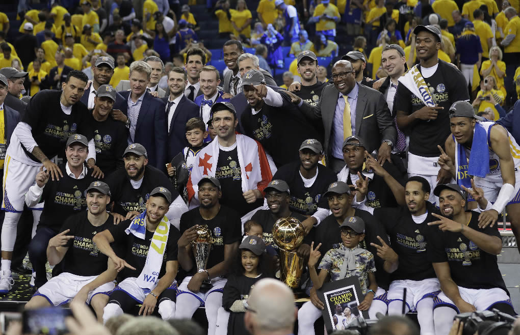 <div class='meta'><div class='origin-logo' data-origin='none'></div><span class='caption-text' data-credit='AP Photo/Marcio Jose Sanchez'>Warriors players, coaches and owners pose for photos after Game 5 of the NBA Finals against the Cavaliers in Oakland, Calif., Monday, June 12, 2017.</span></div>