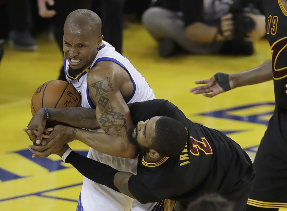 <div class='meta'><div class='origin-logo' data-origin='none'></div><span class='caption-text' data-credit='AP Photo/Marcio Jose Sa'>Warriors forward David West, left, wrestles for the ball with Cavaliers guard Kyrie Irving during the NBA Finals in Oakland, Calif., Monday, June 12, 2017.</span></div>