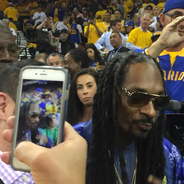 <div class='meta'><div class='origin-logo' data-origin='none'></div><span class='caption-text' data-credit='KGO-TV'>Snoop Dogg is seen inside Oracle Arena in Oakland, Calif. ahead of Game 5 of the NBA Finals on Monday, June 12, 2017.</span></div>