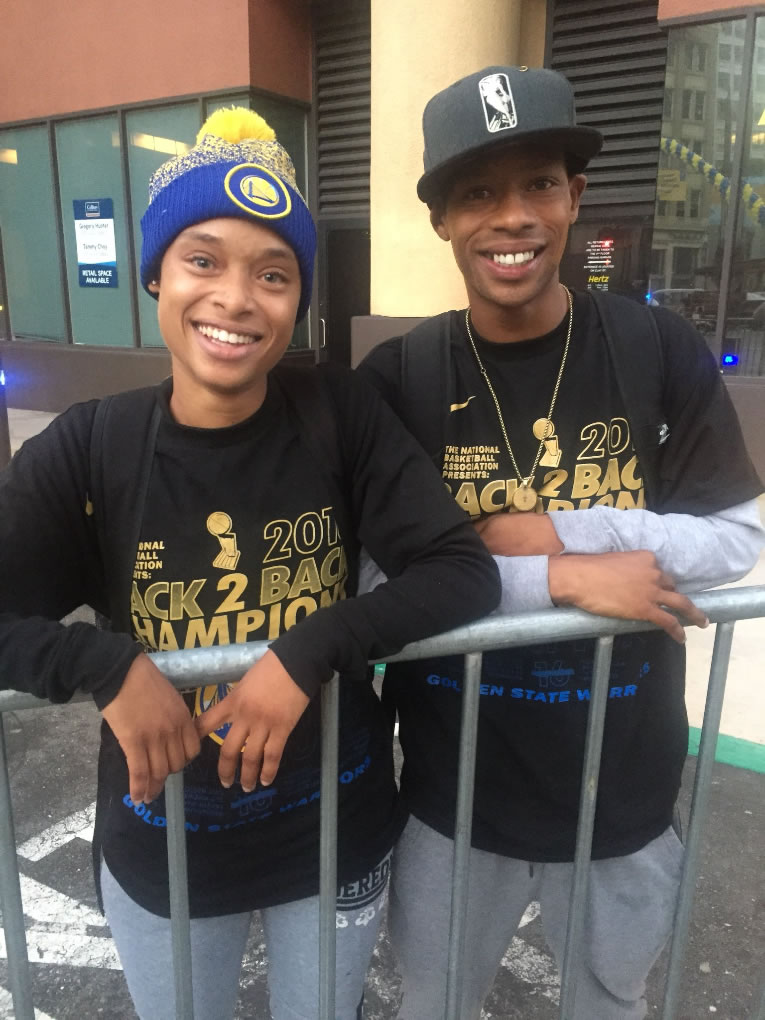 <div class='meta'><div class='origin-logo' data-origin='none'></div><span class='caption-text' data-credit='KGO-TV'>These Warriors fans tell ABC7 News they flew in from Houston to attend the parade in Oakland, Calif. on Tuesday, June 12, 2018.</span></div>