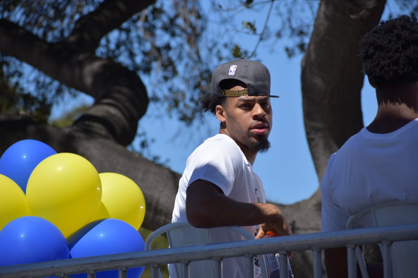 <div class='meta'><div class='origin-logo' data-origin='none'></div><span class='caption-text' data-credit='KGO-TV'>Quinn Cook waits for the Warriors victory parade to begin on Tuesday, June 12, 2018 in Oakland, Calif.</span></div>
