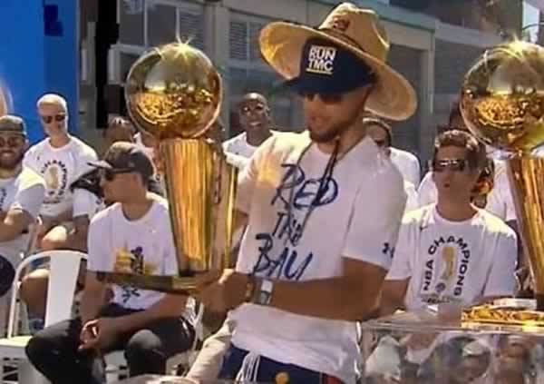 <div class='meta'><div class='origin-logo' data-origin='none'></div><span class='caption-text' data-credit='KGO-TV'>Stephen Curry holds the Larry O'Brien Trophy before the Warriors victory parade in Oakland, Calif. on Tuesday, June 12, 2018.</span></div>