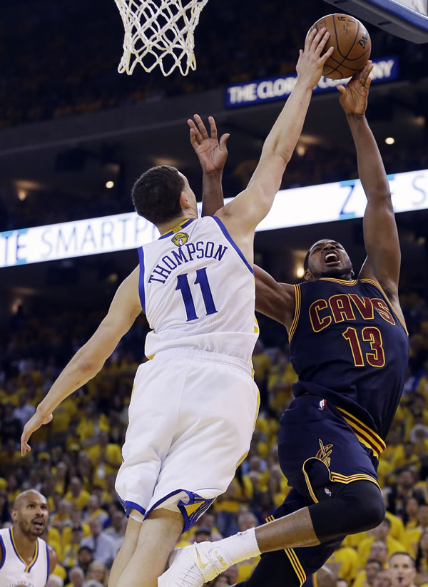 <div class='meta'><div class='origin-logo' data-origin='none'></div><span class='caption-text' data-credit='AP Photo/Ben Margot'>Warriors guard Klay Thompson defends a shot by Cavaliers center Tristan Thompson during Game 5 of the NBA Finals in Oakland, Calif., Sunday, June 14, 2015.</span></div>