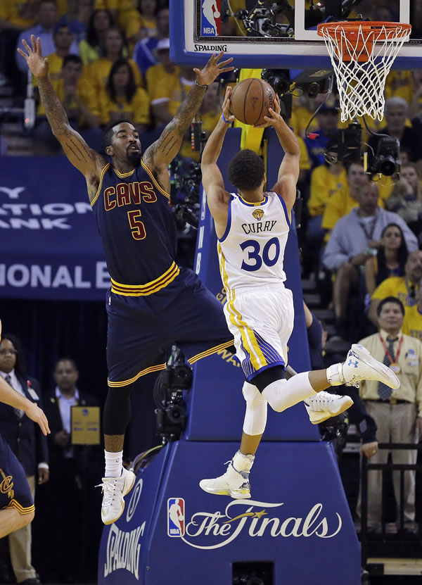 <div class='meta'><div class='origin-logo' data-origin='none'></div><span class='caption-text' data-credit='AP Photo/Ben Margot'>Cavaliers guard J.R. Smith defends as Warriors guard Stephen Curry shoots during the first half of Game 5 of the NBA Finals in Oakland, Calif., Sunday, June 14, 2015.</span></div>