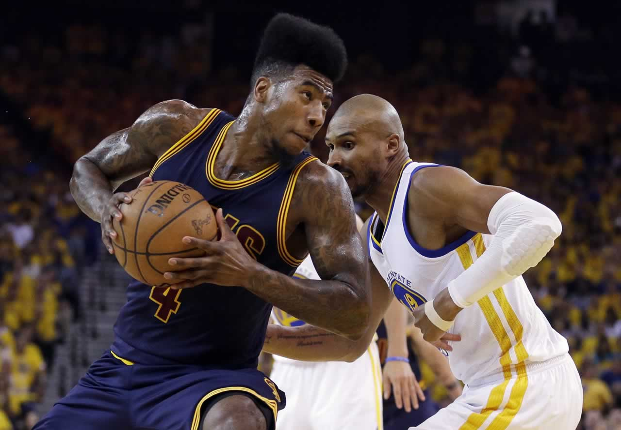 <div class='meta'><div class='origin-logo' data-origin='none'></div><span class='caption-text' data-credit='AP Photo/Ben Margot'>Cavaliers guard Iman Shumpert drives against Warriors guard Leandro Barbosa during Game 5 of the NBA Finals in Oakland, Calif., Sunday, June 14, 2015.</span></div>