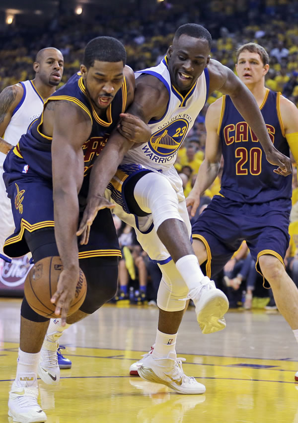 <div class='meta'><div class='origin-logo' data-origin='none'></div><span class='caption-text' data-credit='AP Photo/Ben Margot'>Cavaliers center Tristan Thompson and Warriors forward Draymond Green reach for the ball during the first half of Game 5 of the NBA Finals in Oakland, Calif., Sunday, June 14, 2015</span></div>