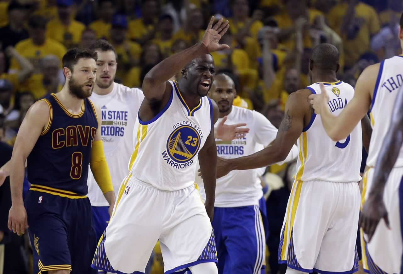 <div class='meta'><div class='origin-logo' data-origin='none'></div><span class='caption-text' data-credit='AP Photo/Ben Margot'>Warriors forward Draymond Green celebrates with teammates in front of Cavaliers guard Matthew Dellavedova during Game 5 of the NBA Finals in Oakland, Calif., Sunday, June 14, 2015.</span></div>