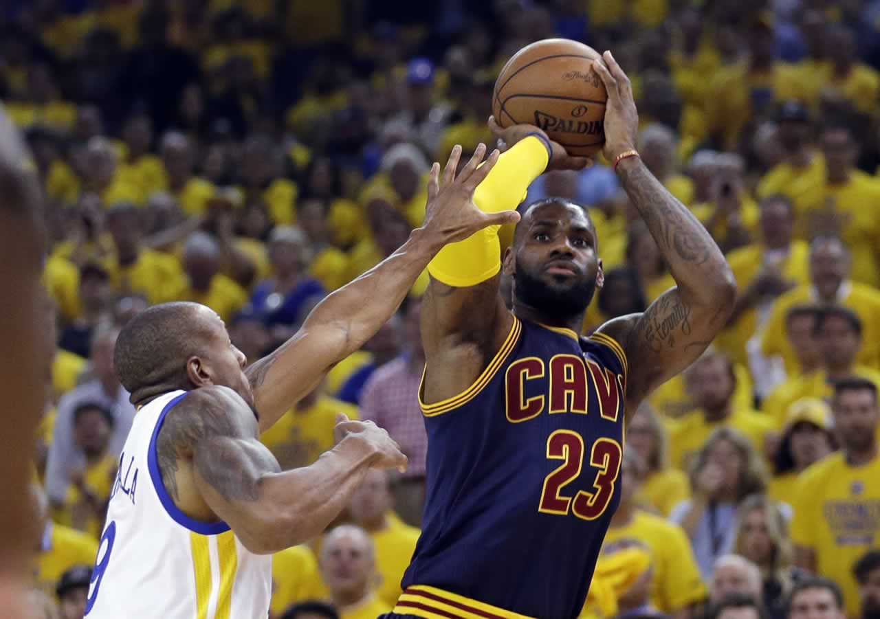 <div class='meta'><div class='origin-logo' data-origin='none'></div><span class='caption-text' data-credit='AP Photo/Ben Margot'>Cavaliers forward LeBron James shoots against Warriors forward Andre Iguodala during Game 5 of the NBA Finals in Oakland, Calif., Sunday, June 14, 2015.</span></div>