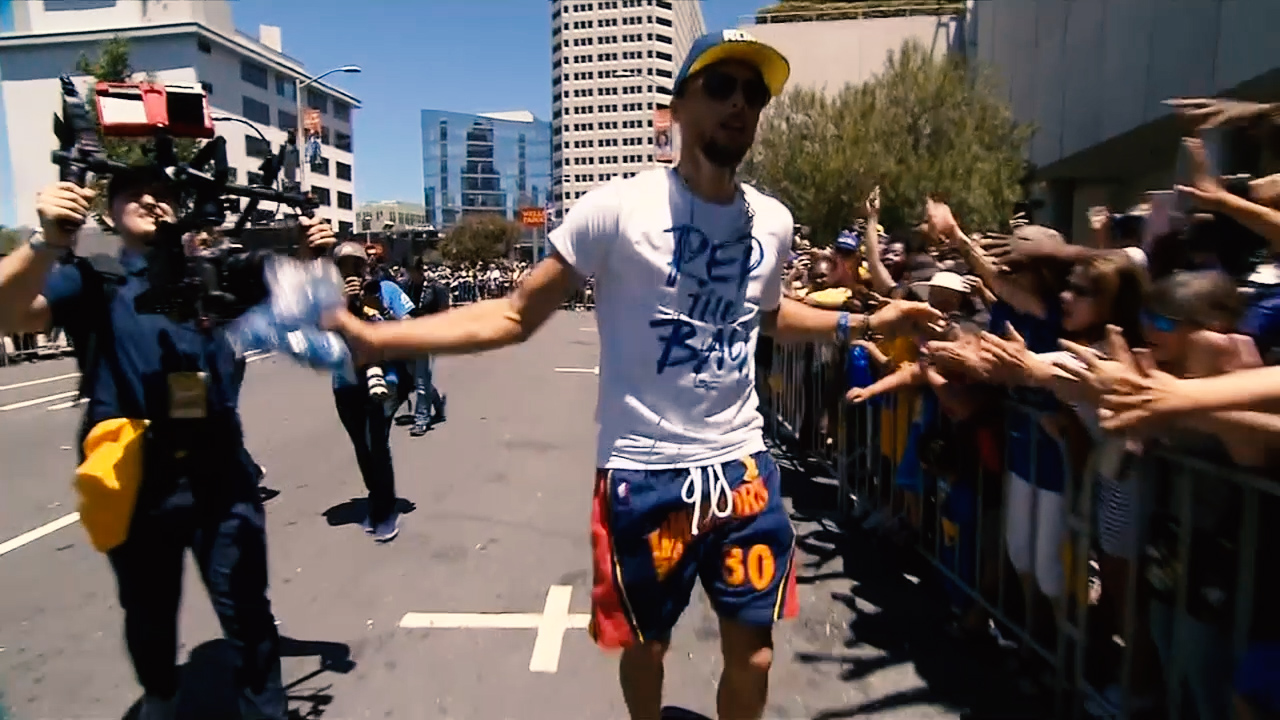 <div class='meta'><div class='origin-logo' data-origin='none'></div><span class='caption-text' data-credit='KGO-TV'>Stephen Curry greets fans during the Warriors parade in Oakland on Tuesday, June 12, 2018.</span></div>