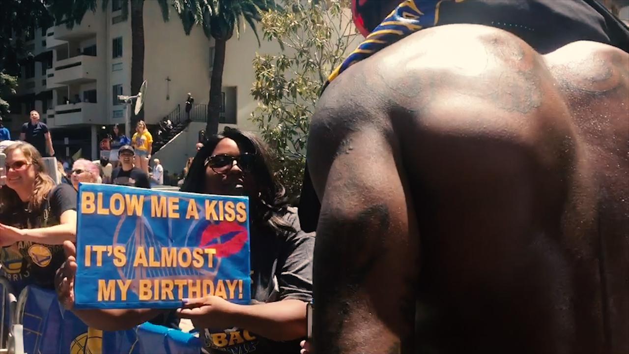 <div class='meta'><div class='origin-logo' data-origin='none'></div><span class='caption-text' data-credit='KGO-TV'>Jordan Bell greets fans during the Warriors parade in Oakland on Tuesday, June 12, 2018.</span></div>
