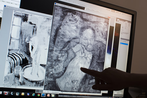 "An image of a man found underneath one of Picasso's first masterpieces, ""The Blue Room,"" is pointed out on June 10, 2014, in Washington. (AP Photo/ Evan Vucci)"