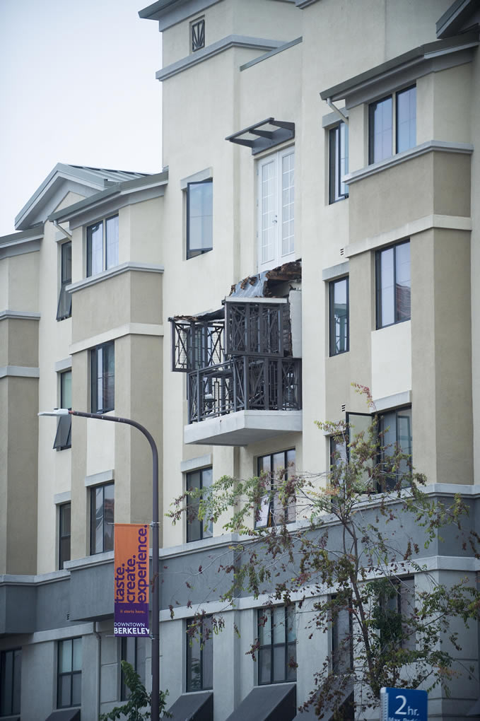 <div class='meta'><div class='origin-logo' data-origin='none'></div><span class='caption-text' data-credit='AP Photo/Noah Berger'>A fourth floor balcony railing rests on the balcony below at the Library Gardens apartment complex in Berkeley, Calif. on Tuesday, June 16, 2015. (AP Photo/Noah Berger)</span></div>